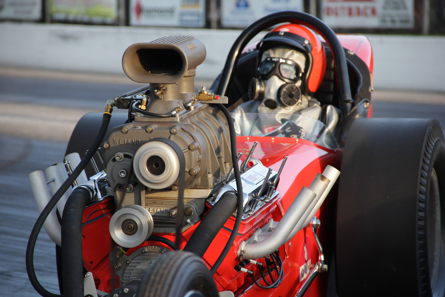 Weiand supercharger sitting on top of a Chevy small block V-8