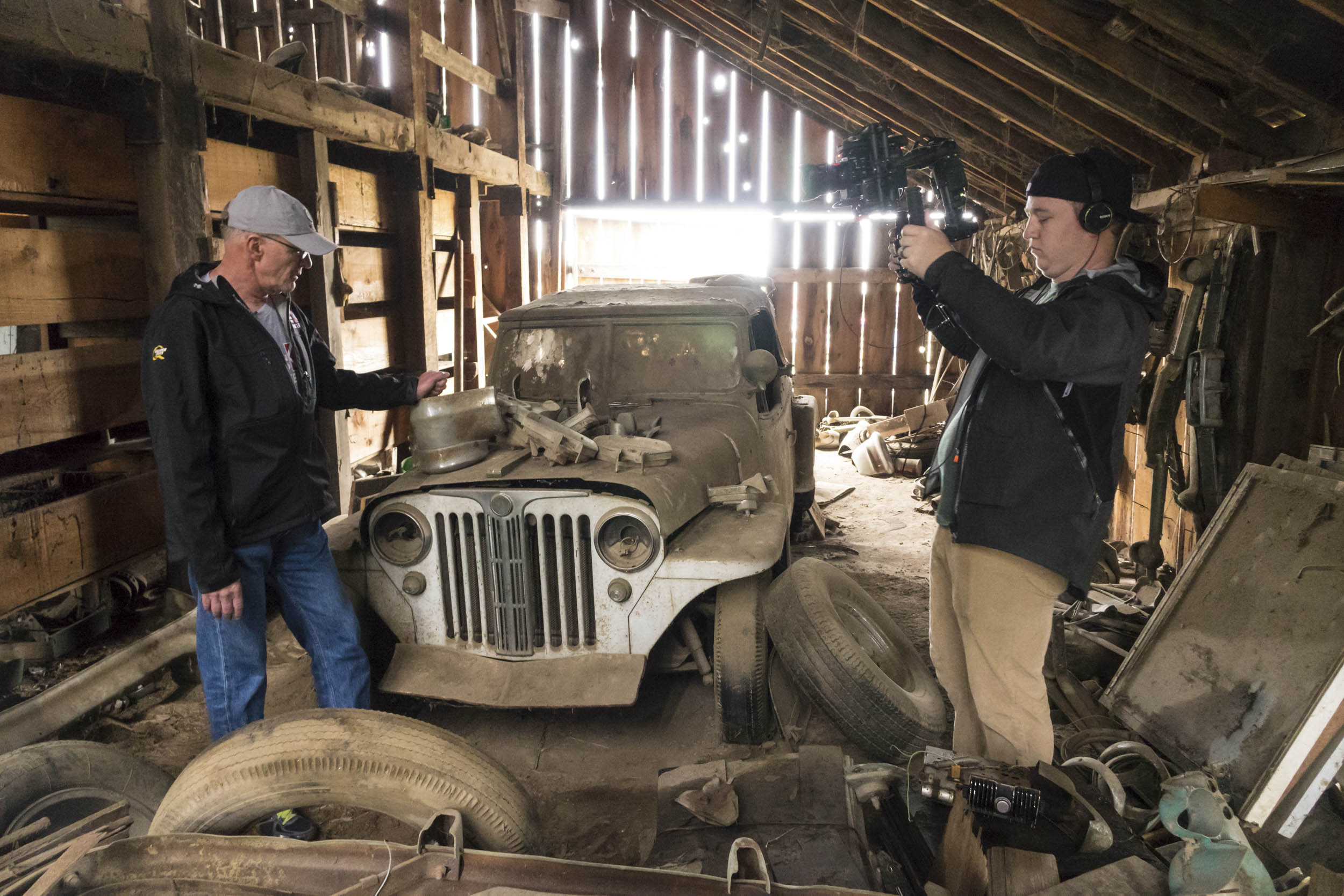 Our man Tom Cotter (left) wades through the junk and the rat doo-doo for the neglected and the forgotten, such as this old Jeepster. He has tales to tell and cars yet to find.