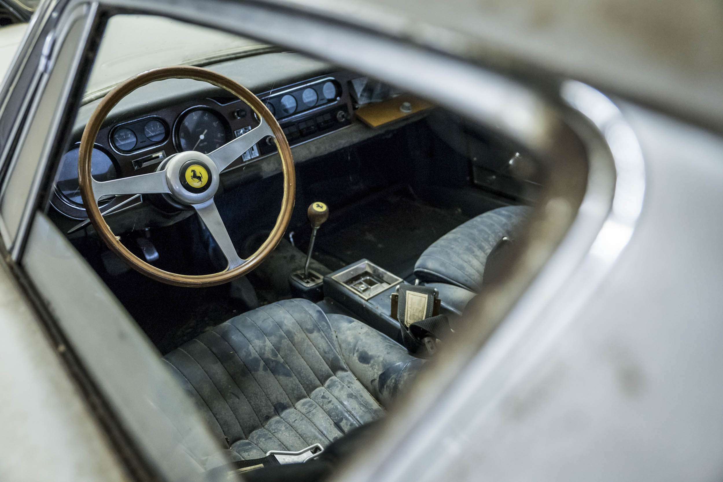 The 13,000-km exotic was exhumed from its dusty cell and sent to auction, where it was sold in asfound condition, filth and all. The bidding was hot and heavy.