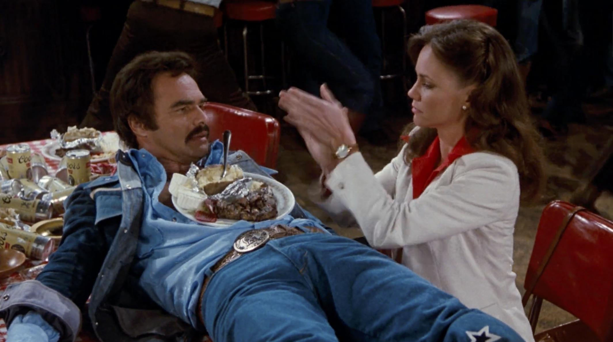 Burt Reynolds Hooper on table with food