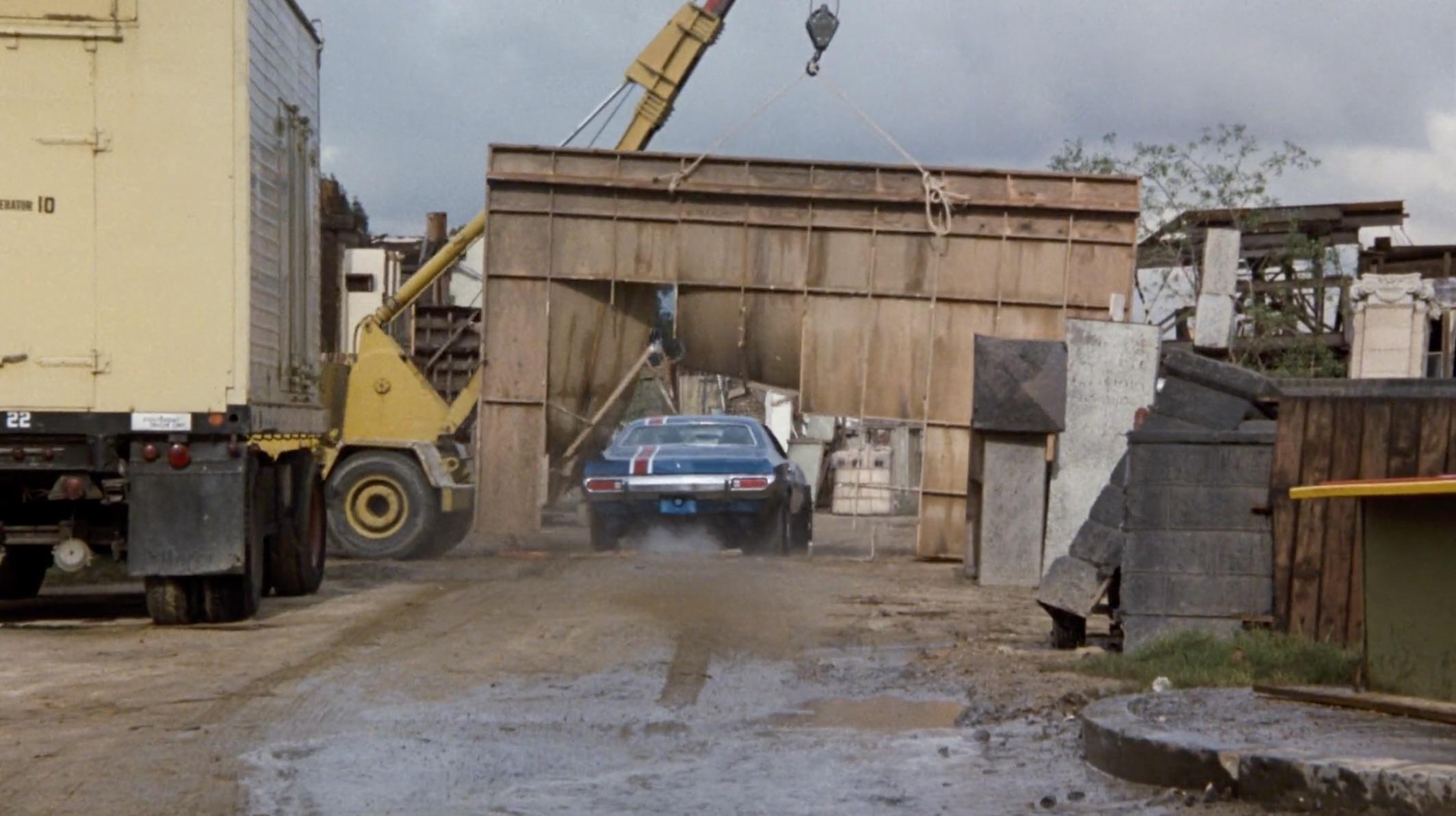 Burt Reynolds Hooper blue car crash through wall