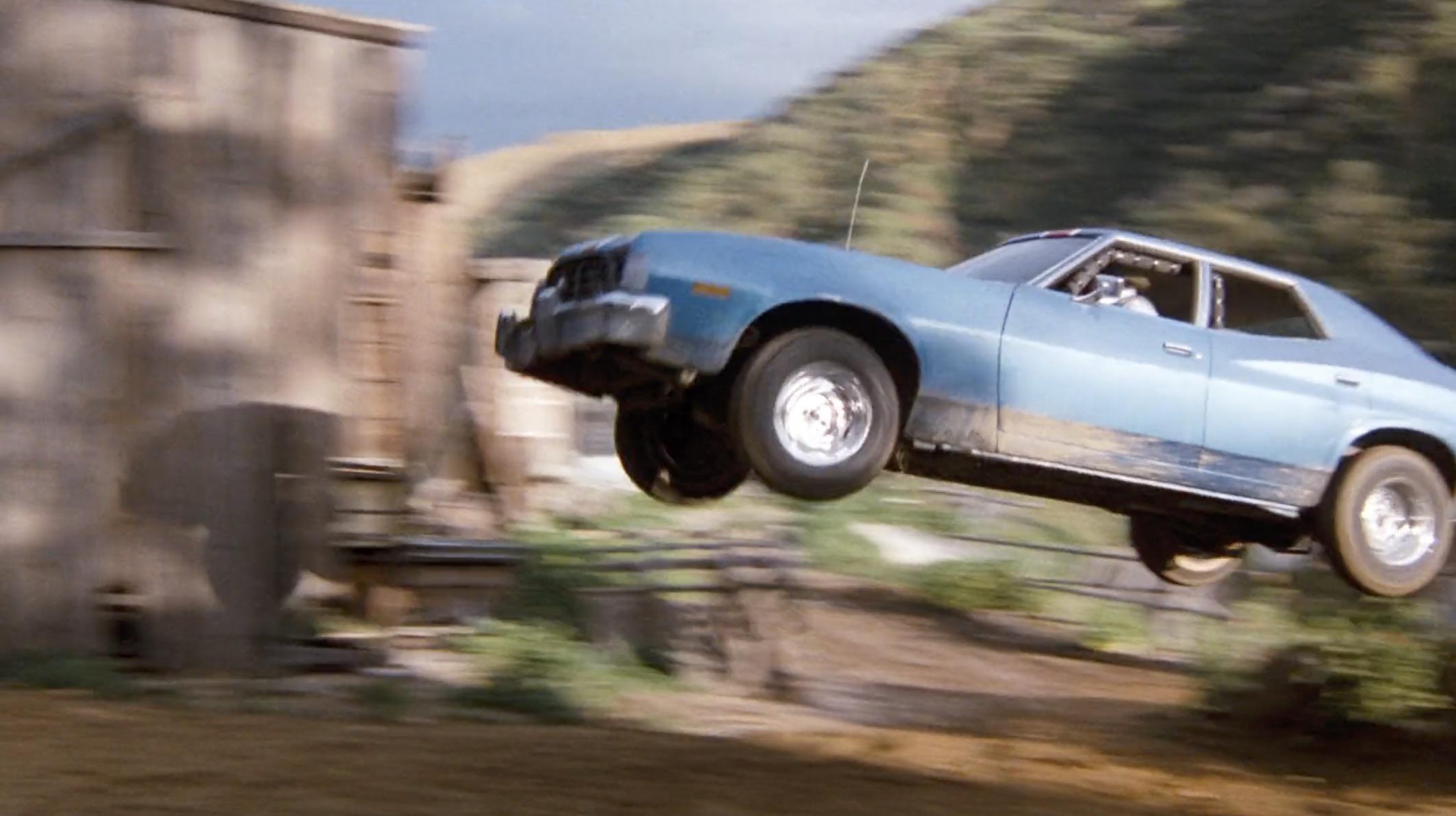 Burt Reynolds Hooper blue car jump