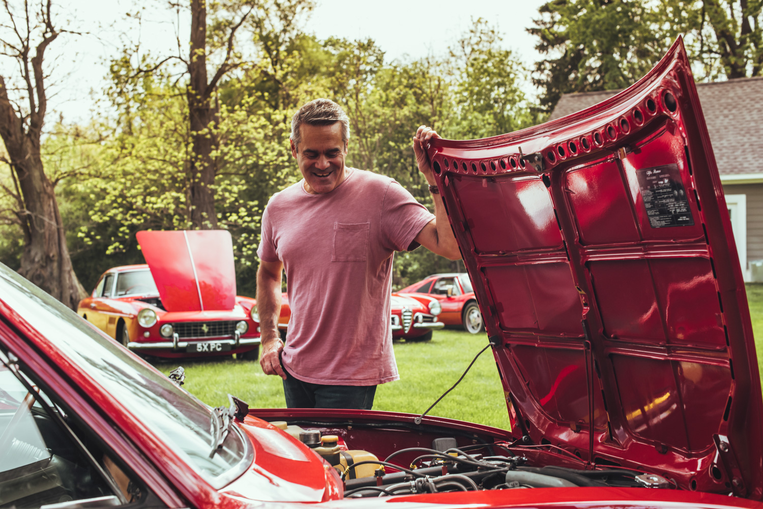Bob shows off the pristine engine bay of his 1975 Alfetta, which he bought for  alt=
