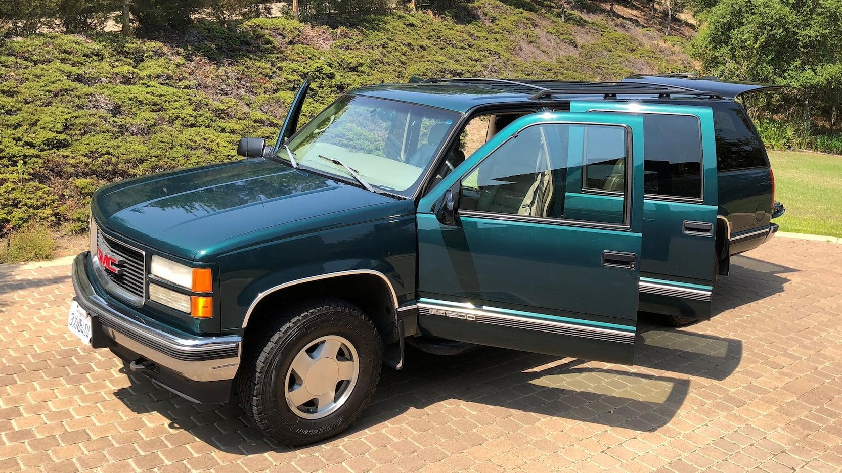 1998 GMC Suburban SLT doors open wide
