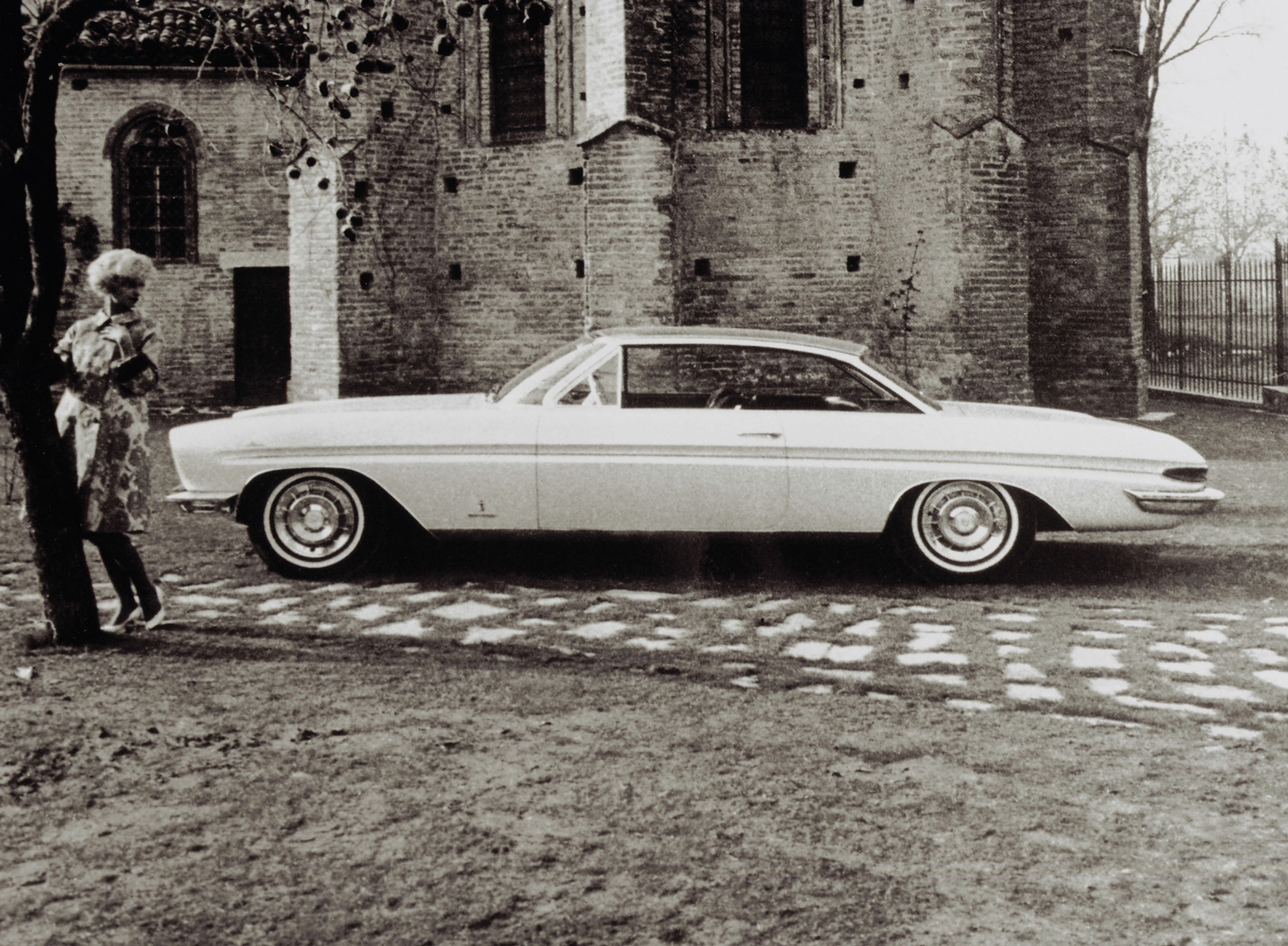 The 1961 Cadillac Jacqueline by Pininfarina. The car was built on a 1960 Eldorado Brougham chassis, then removed from that chassis and put on a tubular structure. It was built in honor of Jacqueline Bouvier Kennedy. The golden two-door featured a brushed steel roof and no back seat.