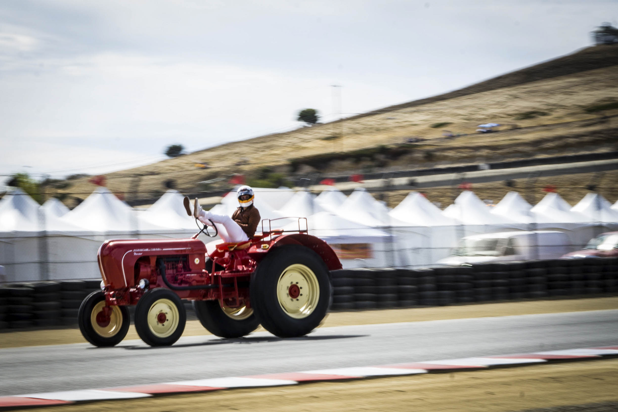 A Le Mans start to a tractor race featuring Porsche factory drivers sounds like fan fiction. We're not sure who came up with the idea, but whoever you are, you're a genius. Of course the tractor race was not as heated as the rest of the events at Rennsport. This competitor looks pretty relaxed.