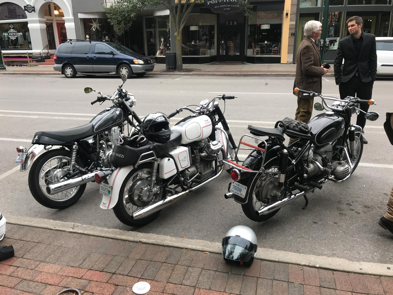 Distinguished Gentlemen Ride BMW Moto Guzzi parked