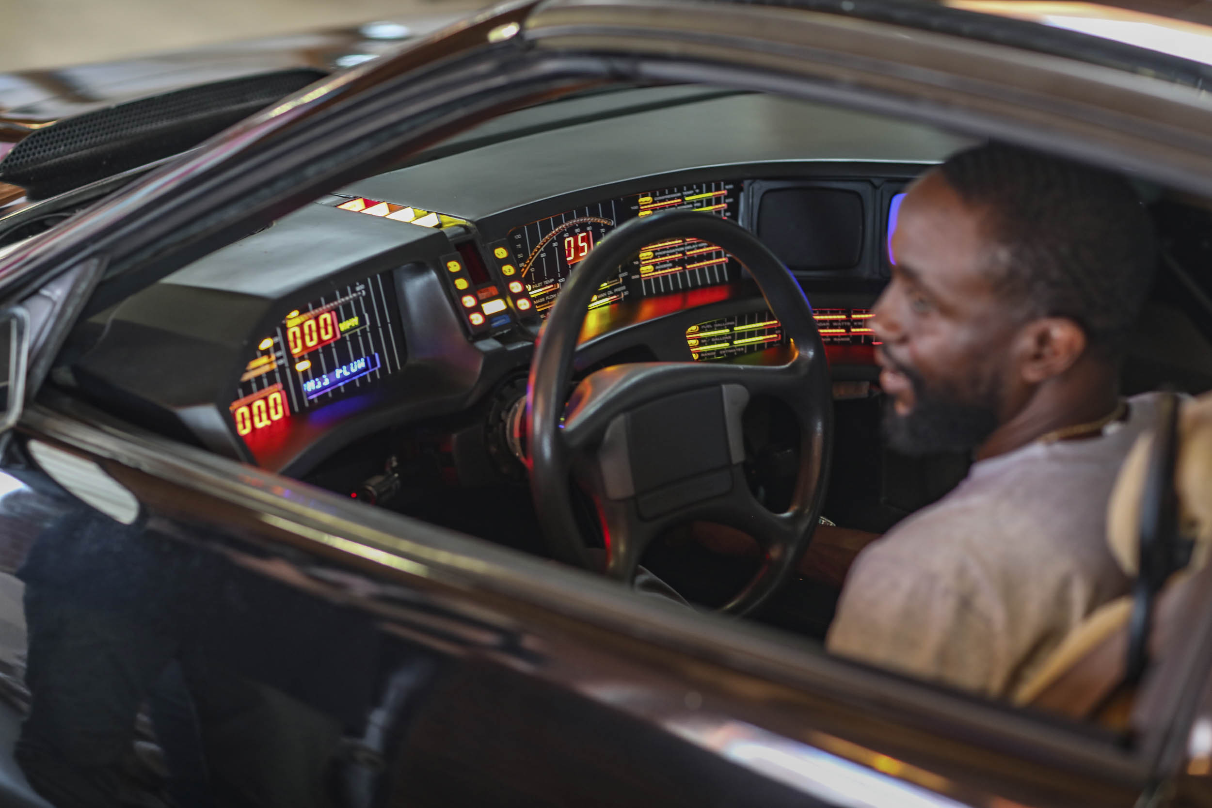 Byron Bowers behind the wheel of K.I.T.T.
