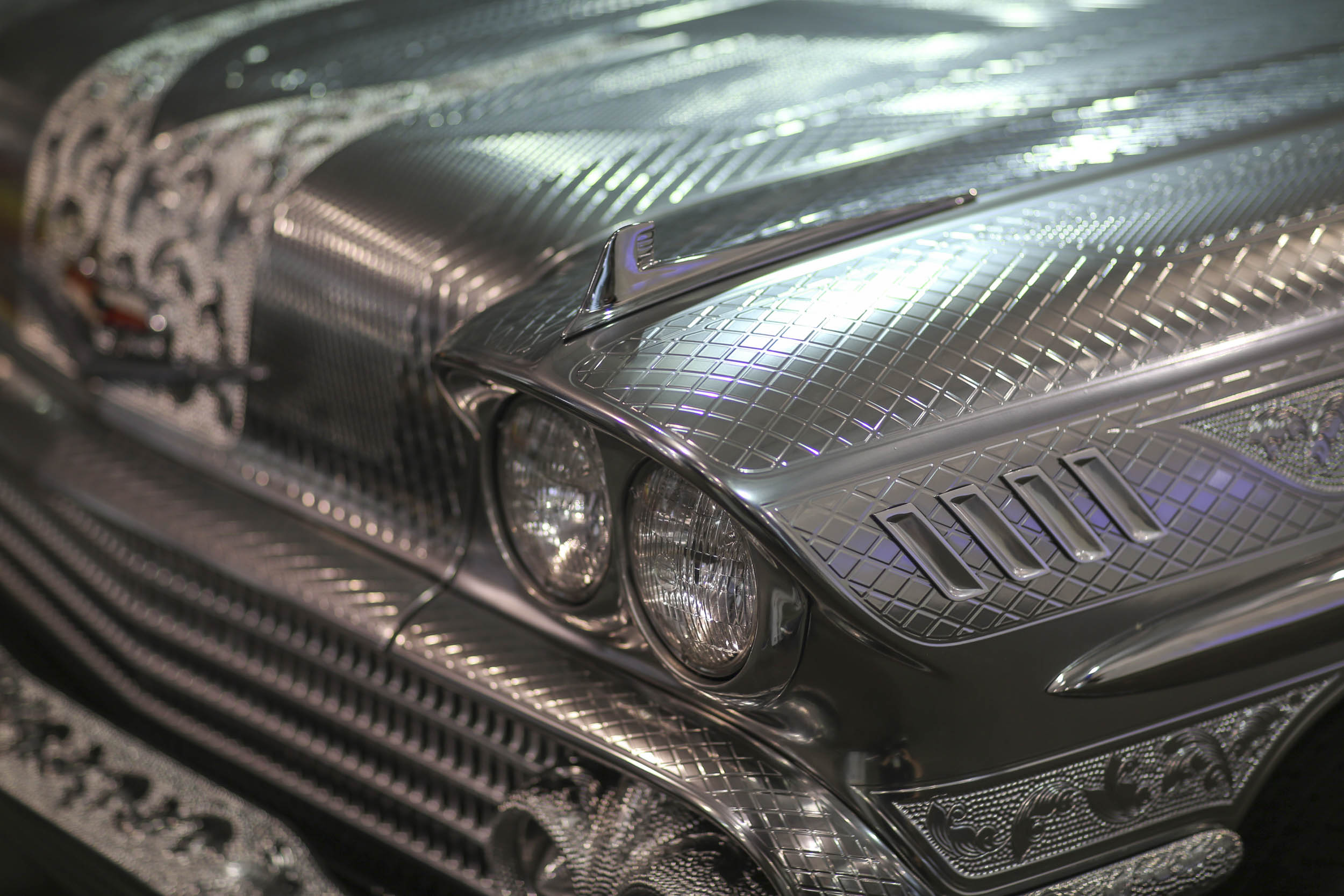 this '58 Impala that looks like it's covered in quilted bare metal is actually painted to provide that illusion.