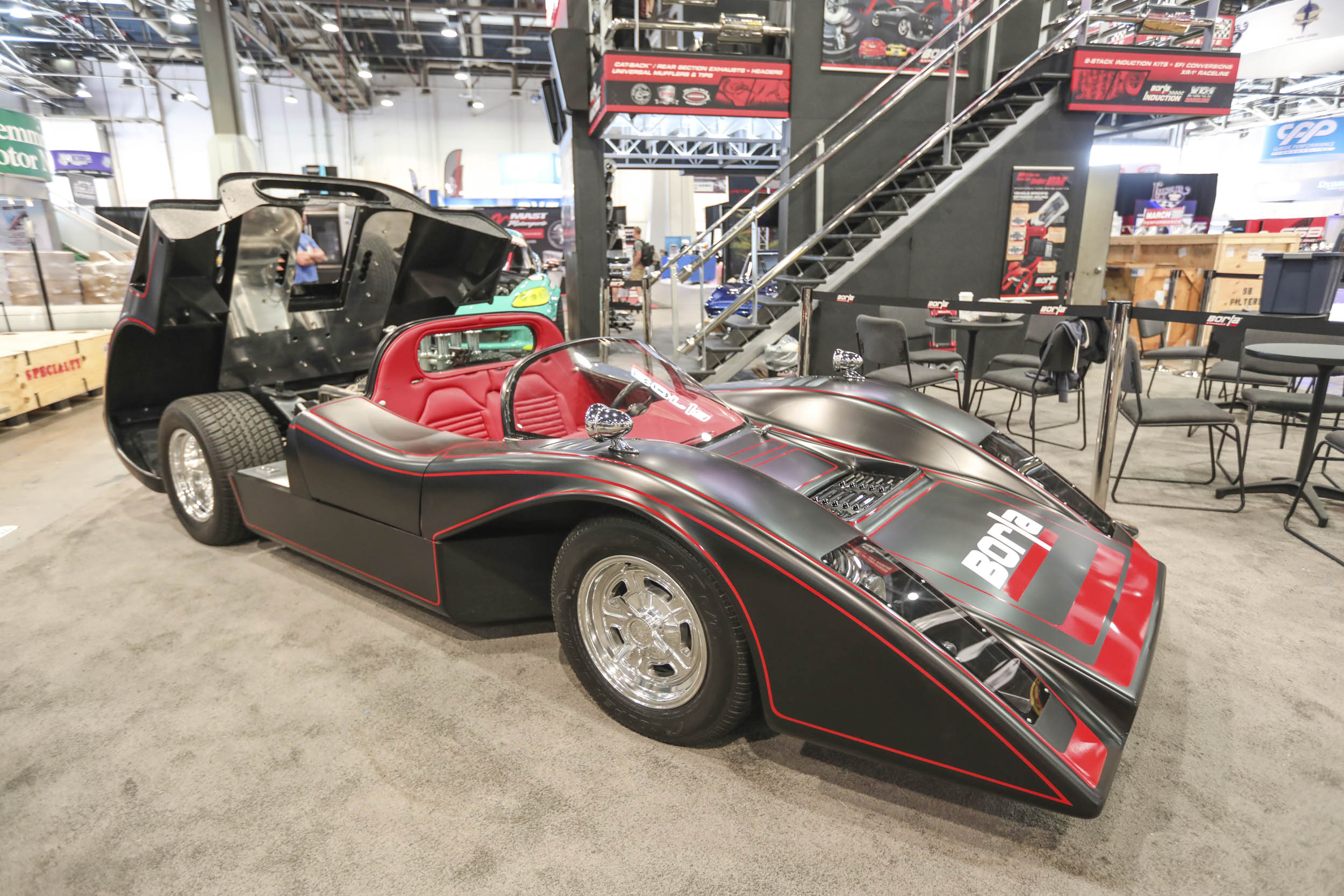 Borla displayed this flat black and red Manta Mirage built by Counts Kustoms.