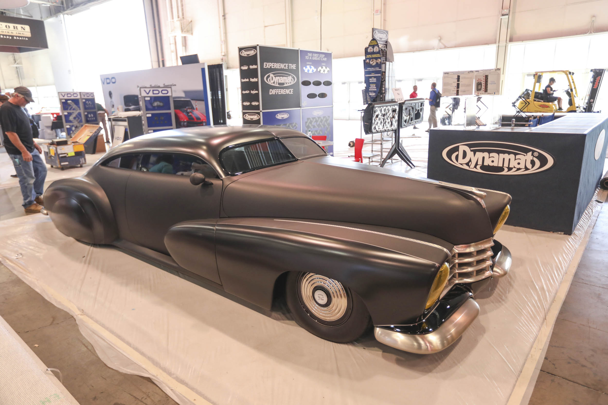 This black on black Cadillac lead sled in the Dynamat booth looks like it belongs in Batman the Animated Series