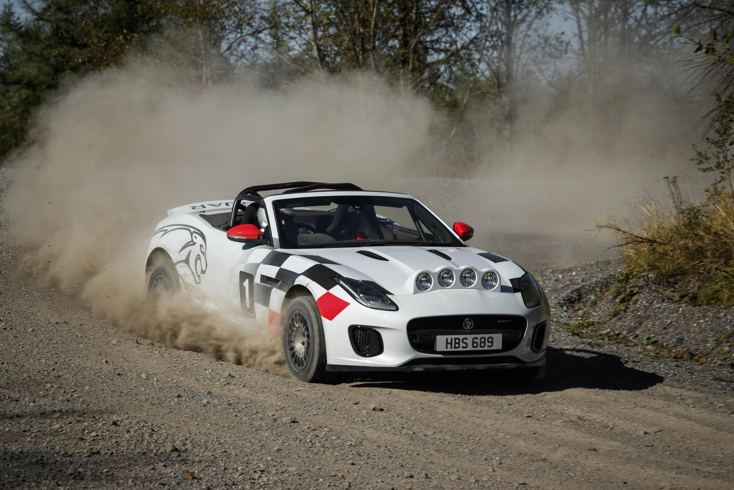 Jaguar F-type convertible rally car kicking up dirt