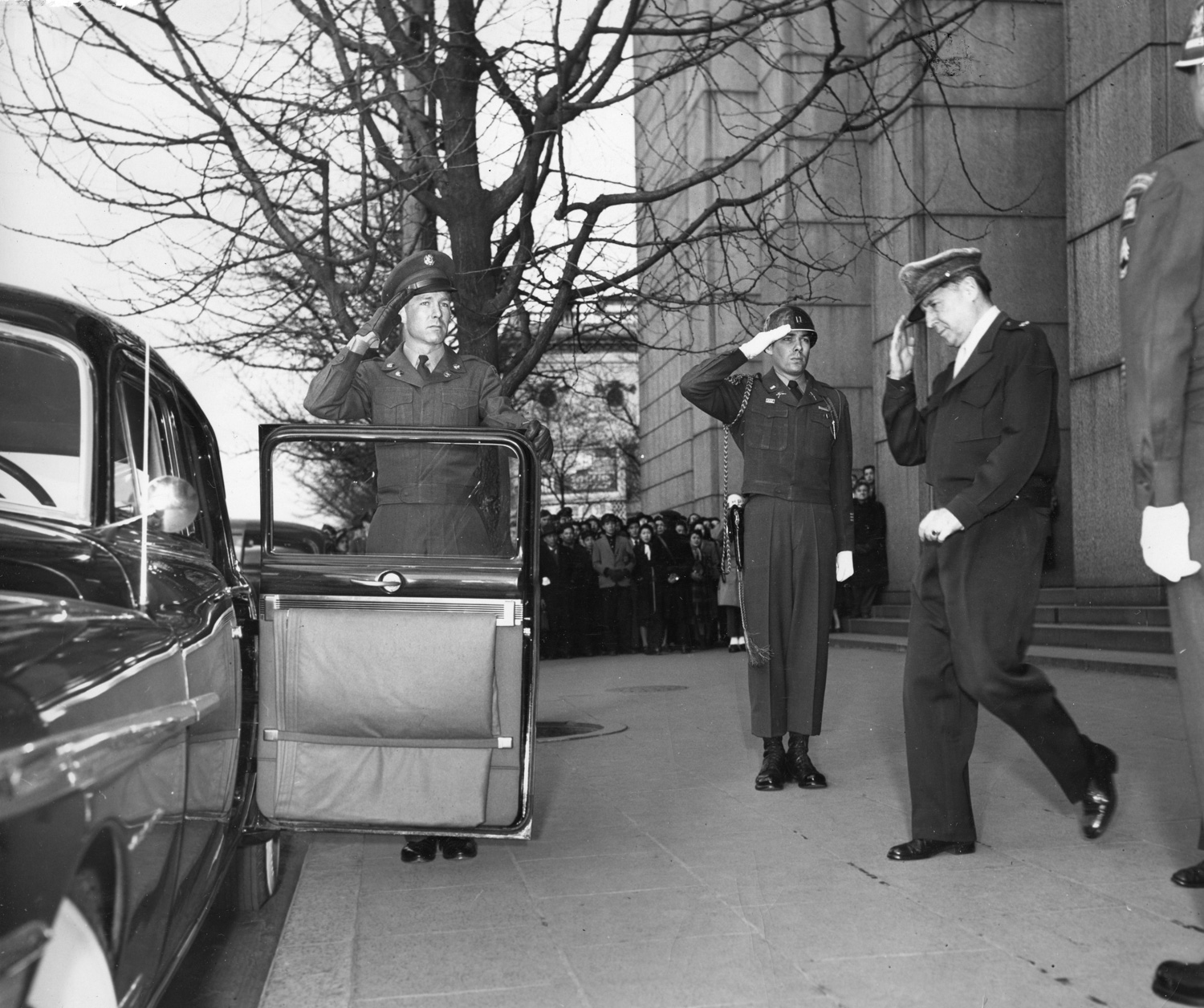 MacArthur leaves his office at the Dai Ichi Insurance Building in Tokyo on his 71st birthday in 1951.