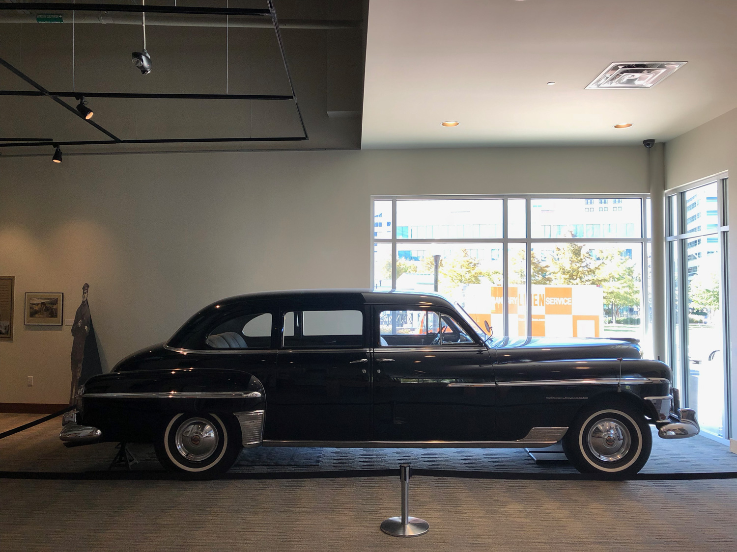 MacArthur's 1950 Chrysler Crown Imperial limousine as it appears today at the MacArthur Memorial in Norfolk, Virginia. It is currently jacked up to preserve the original tires, and the entire car is original and unrestored.