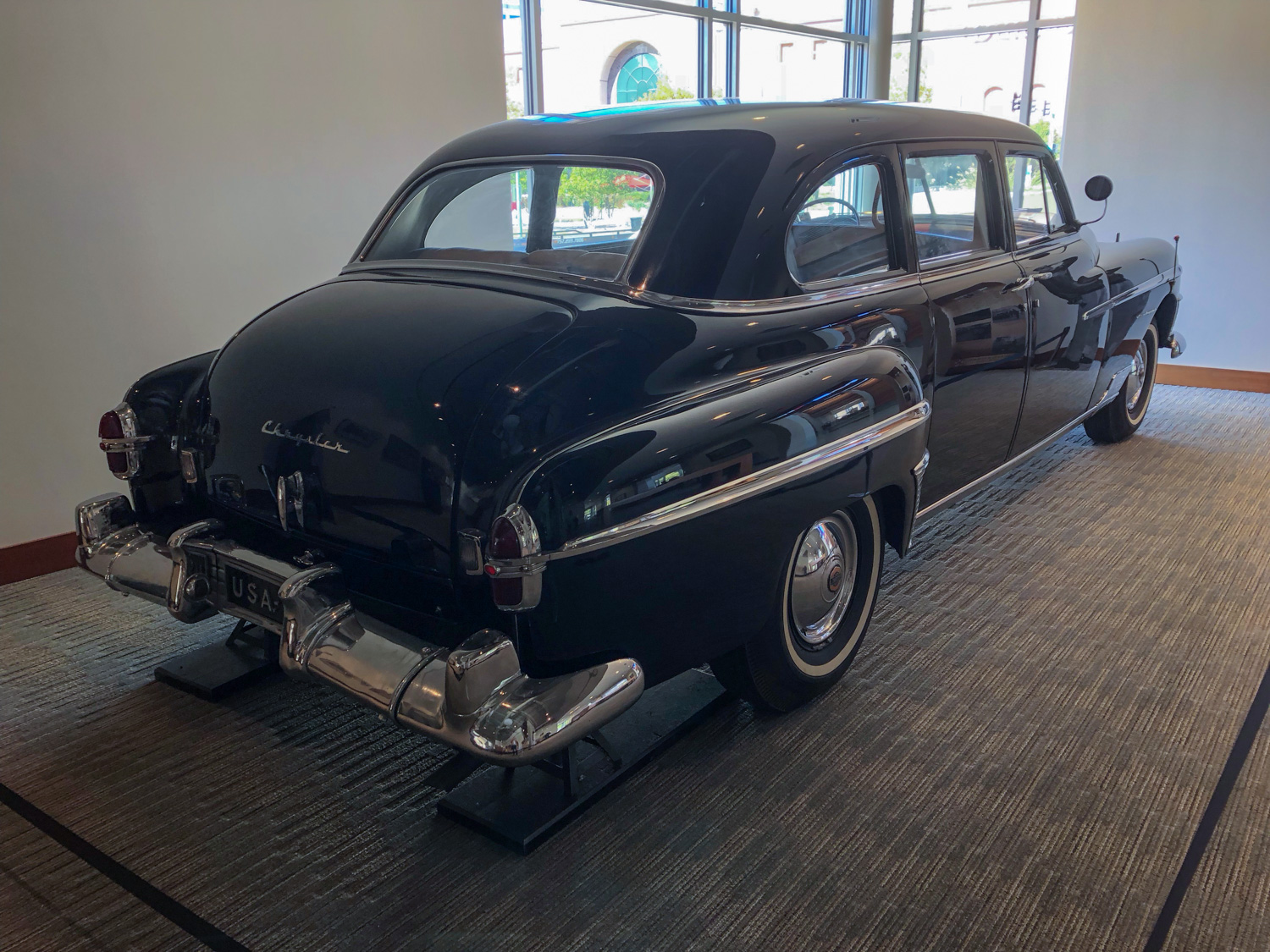 To reach the spare tire compartment of MacArthur's 1950 Chrysler Crown Imperial limousine, the rear bumper had to be removed.