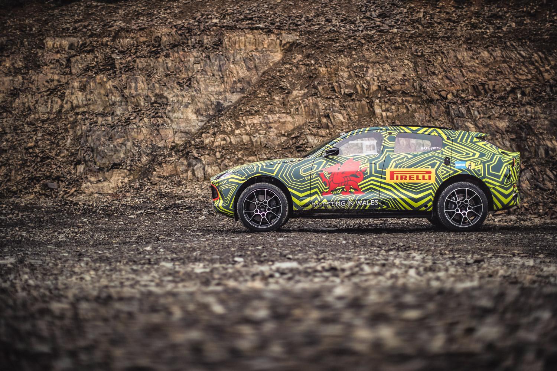 Aston Martin DBX prototype side profile rock wall