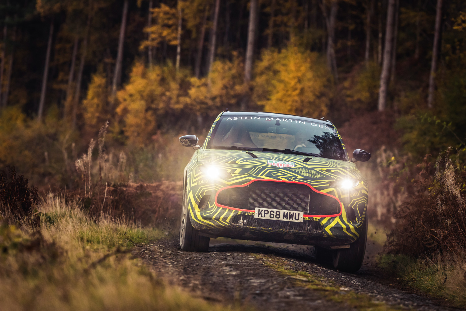 Aston Martin DBX prototype driving in woods