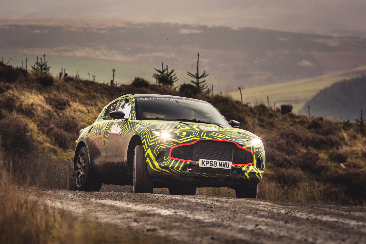 Aston Martin DBX prototype drifting off road