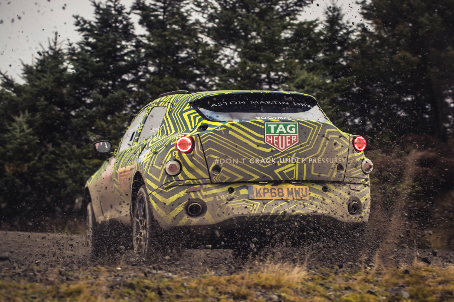 Aston Martin DBX prototype rear kicking up dirt