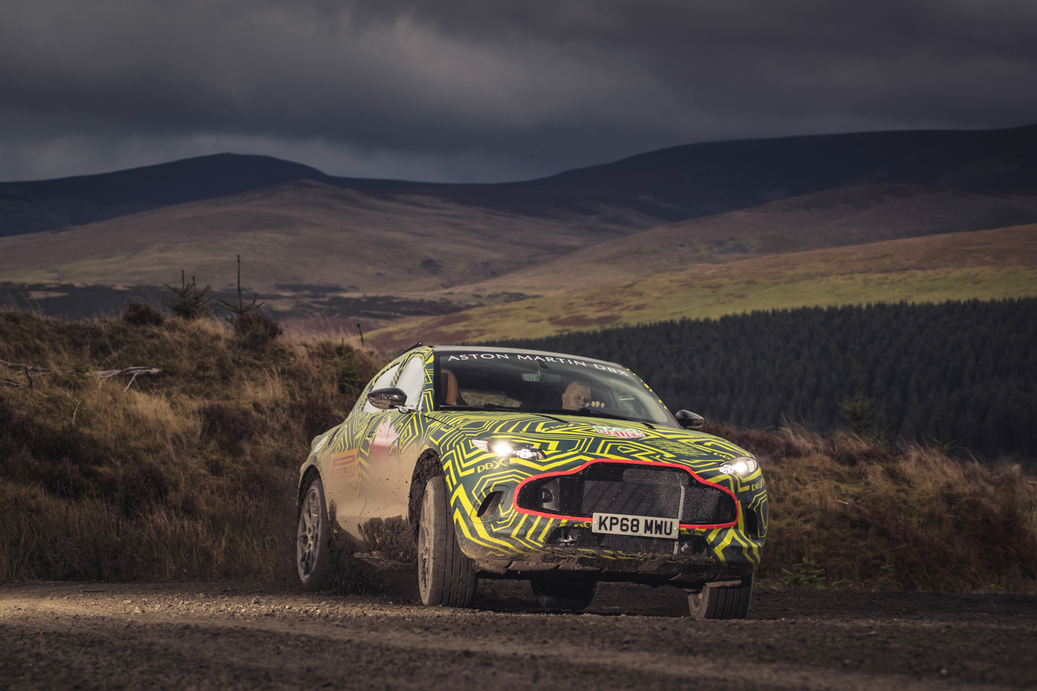 Aston Martin DBX prototype 3/4 off road dirt covered