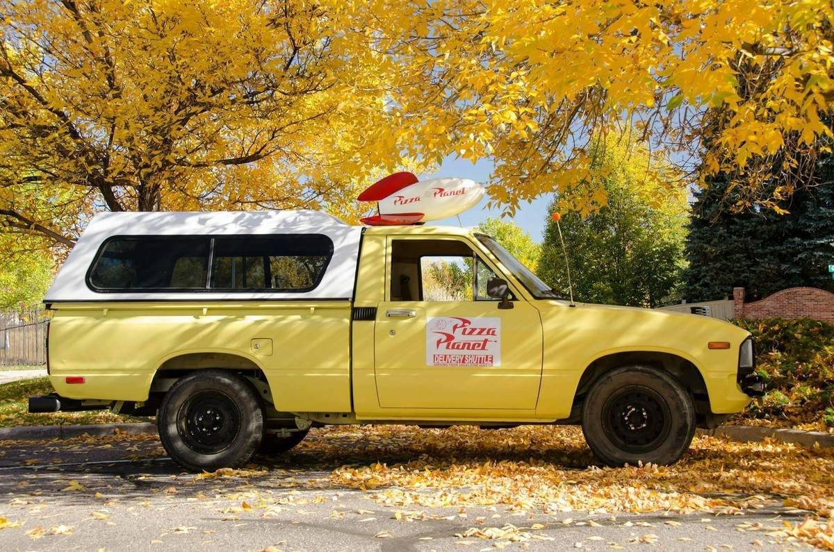 This Toy Story Pizza Planet Toyota pickup is Radwood gold thumbnail