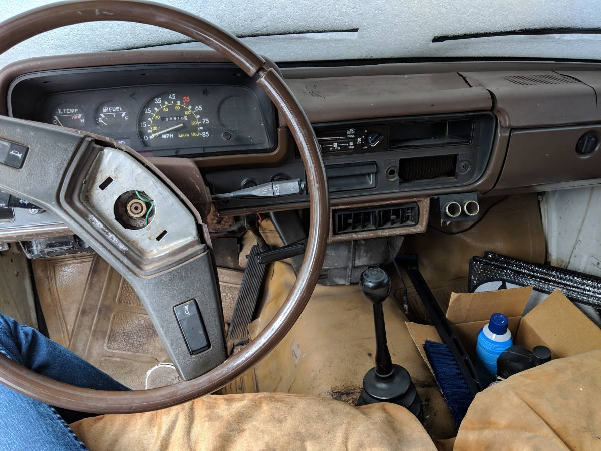"1983 Toyota Pickup ""Pizza Planet"" interior stick shift toy story"
