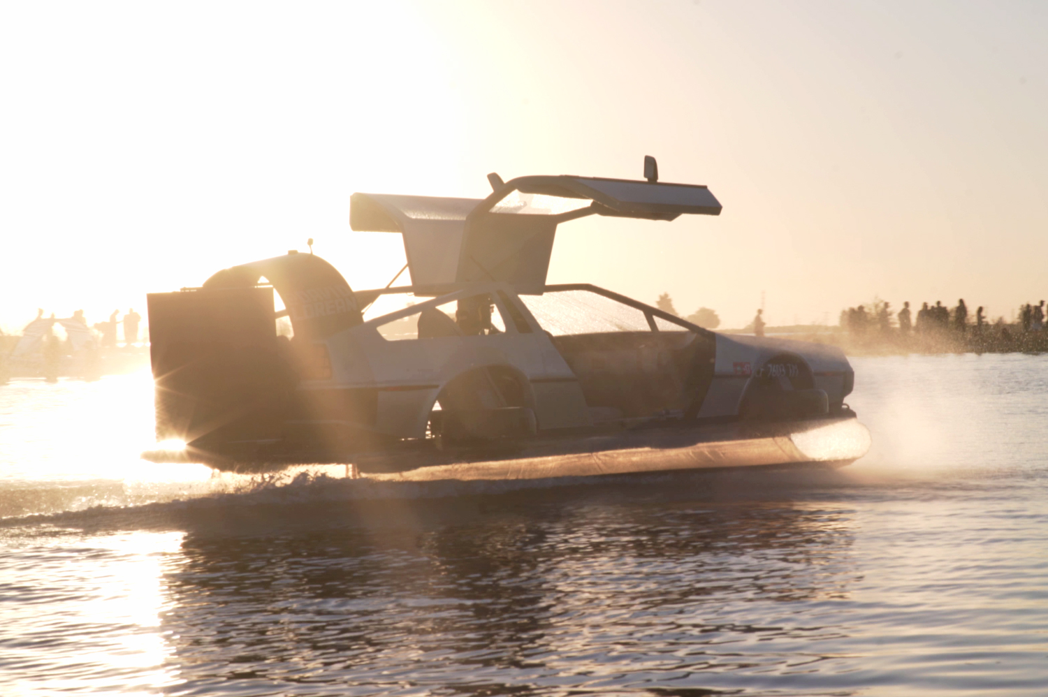 delorean hovercraft doors up side sunset