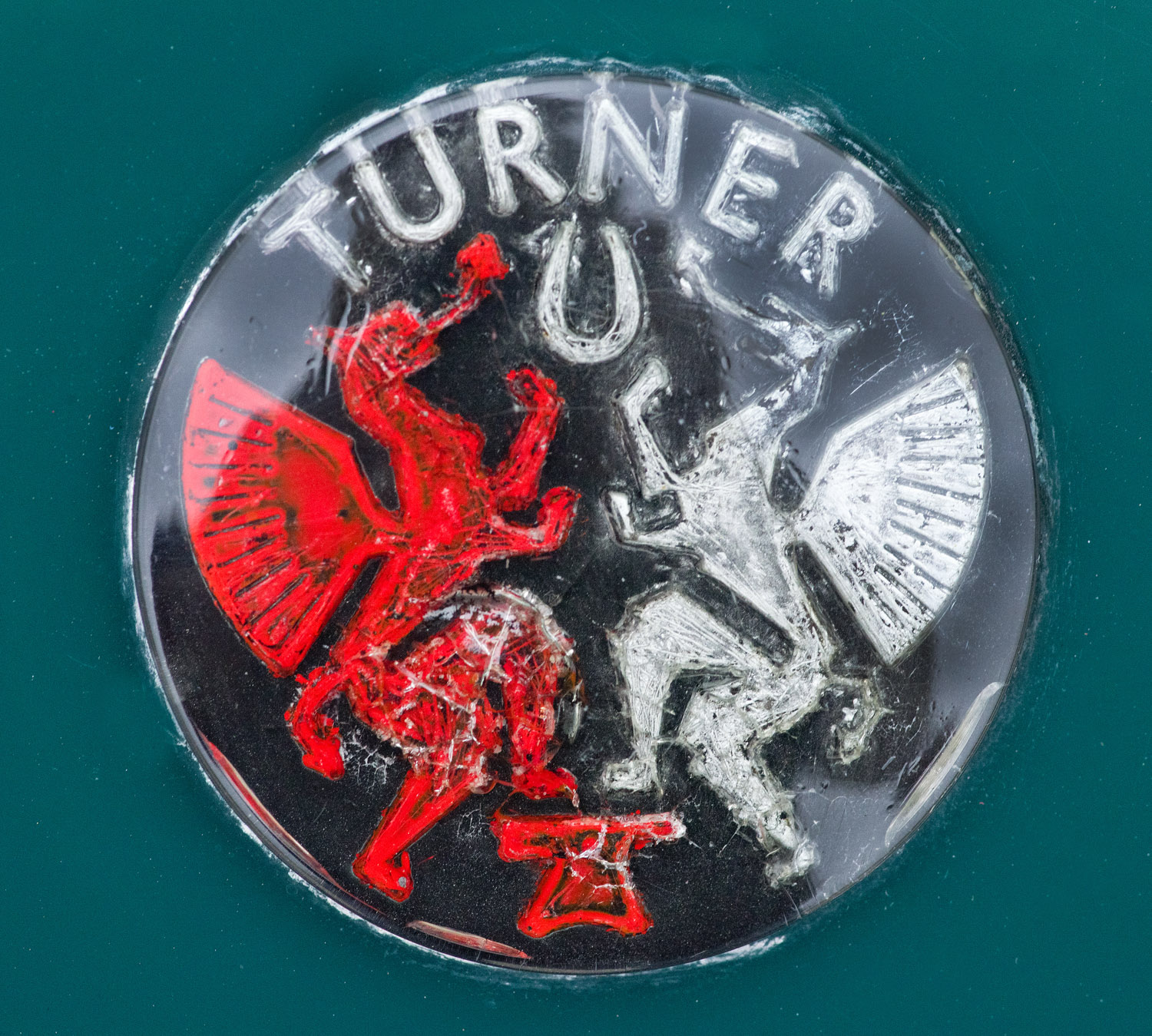 The Turner emblem on the hood of John Ruth's Mark III. The dragon is a symbol of Wales, dating from the fifth century.