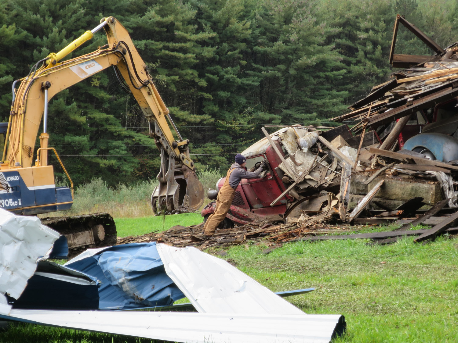 Barn collapse excavator