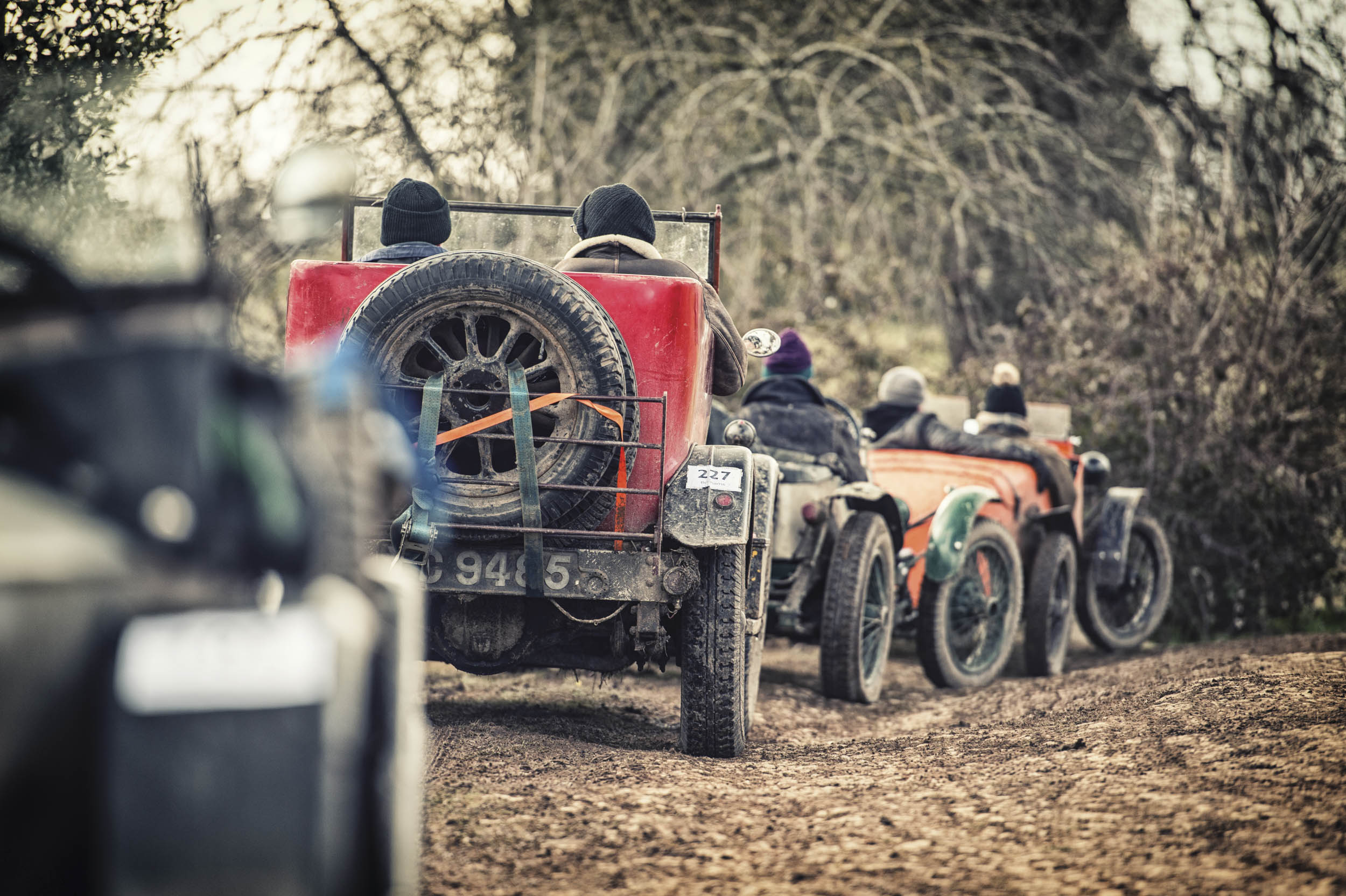 An 88-year-old Morris Cowley roadster waits in a line of Austin Sevens to run a hill. In trialing, as in drag racing, there's a lot of waiting around, but in cold mud.