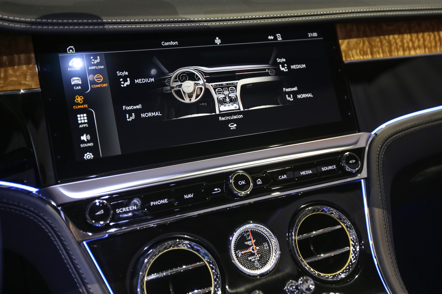 Bentley gives driver two different options for the center stack when driving, one digital, the other analog. info screen