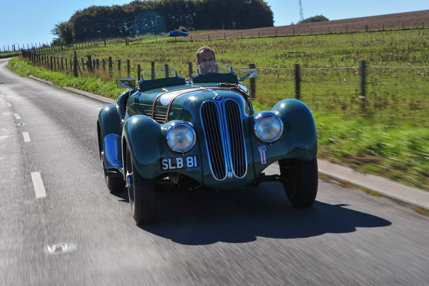 BMW 328 on road sunny 3/4 front