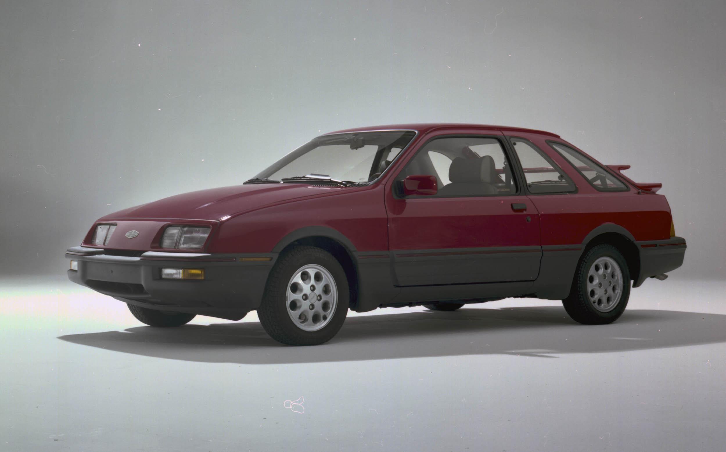 Red 1985 Merkur XR4ti front 3/4