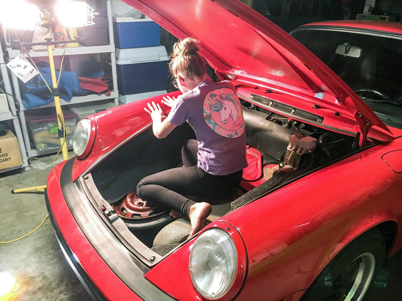 porsche 911 daughter helping fix trunk