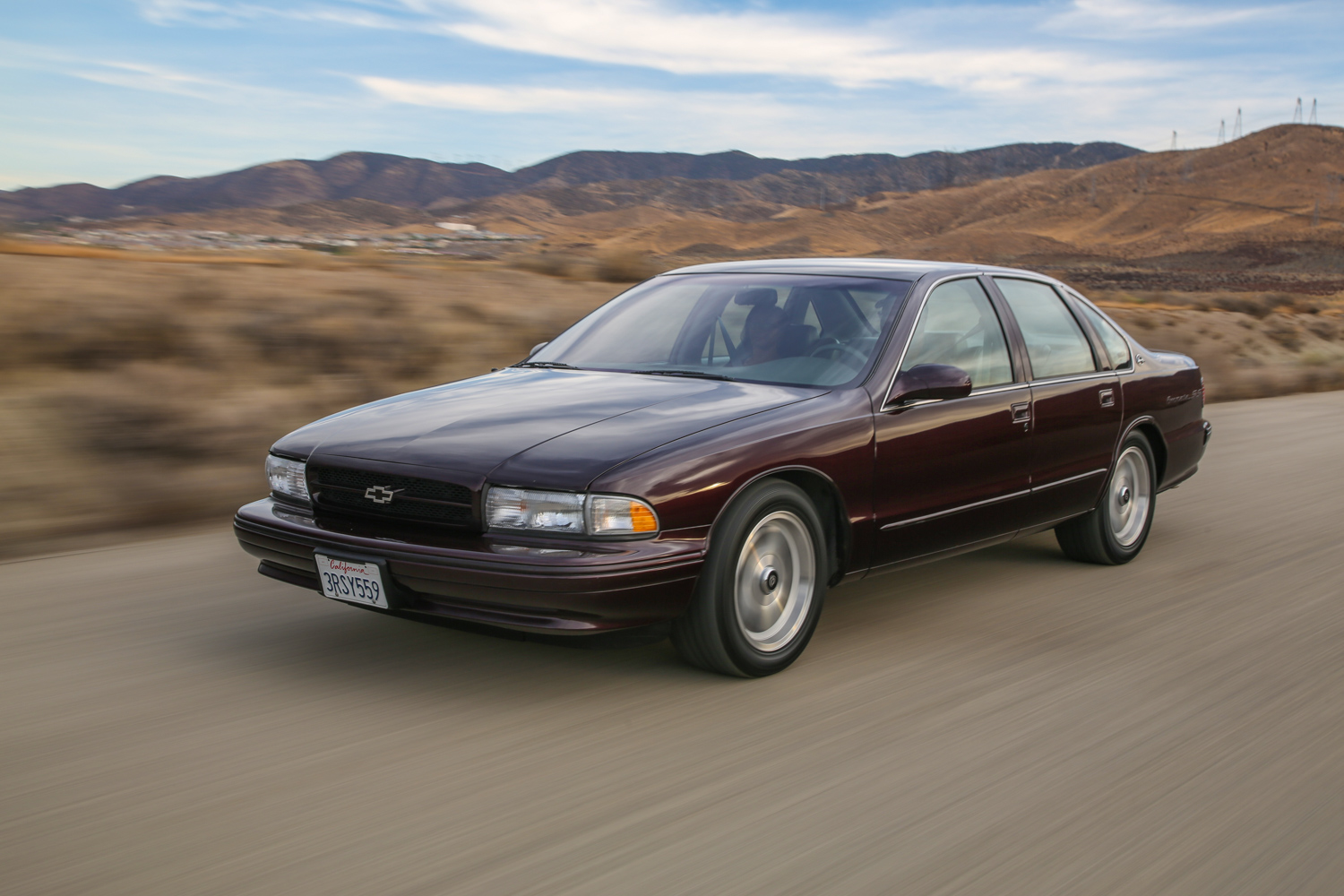 1996 Chevrolet Impala SS driving 3/4 front