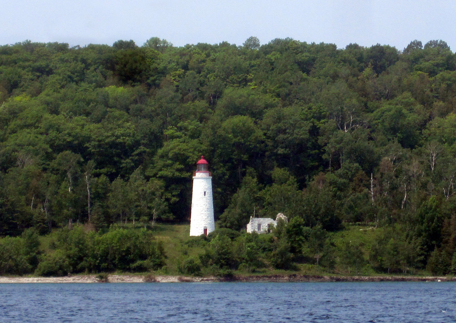 """The MANASOO sank in the middle of the night while try- ing to reach the Griffith Island Lighthouse, one of only six """"imperial"""" lights on Georgian Bay, built in 1858 and still in use (although automated) to- day."""