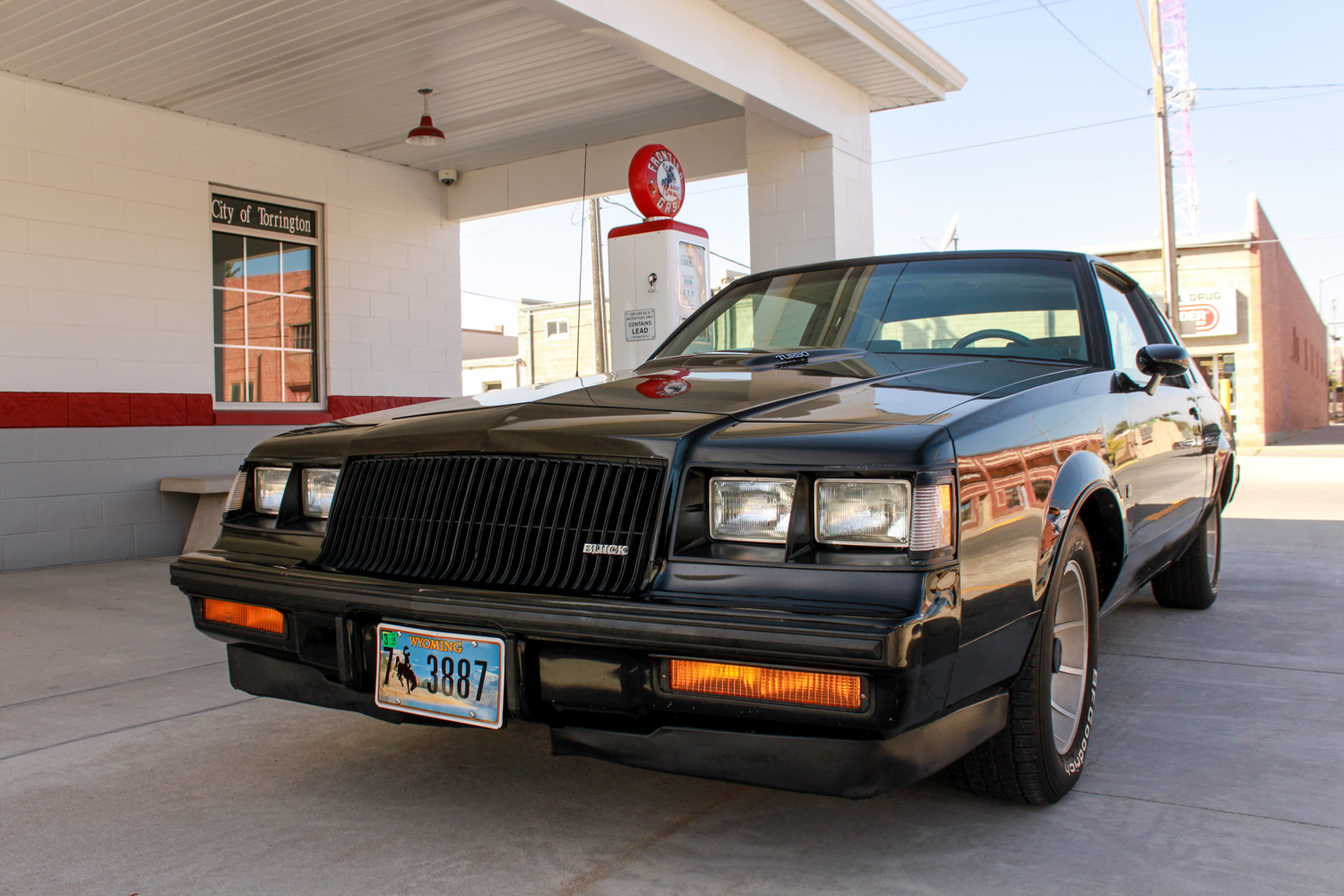 1987 Buick turbo-T by gas pump