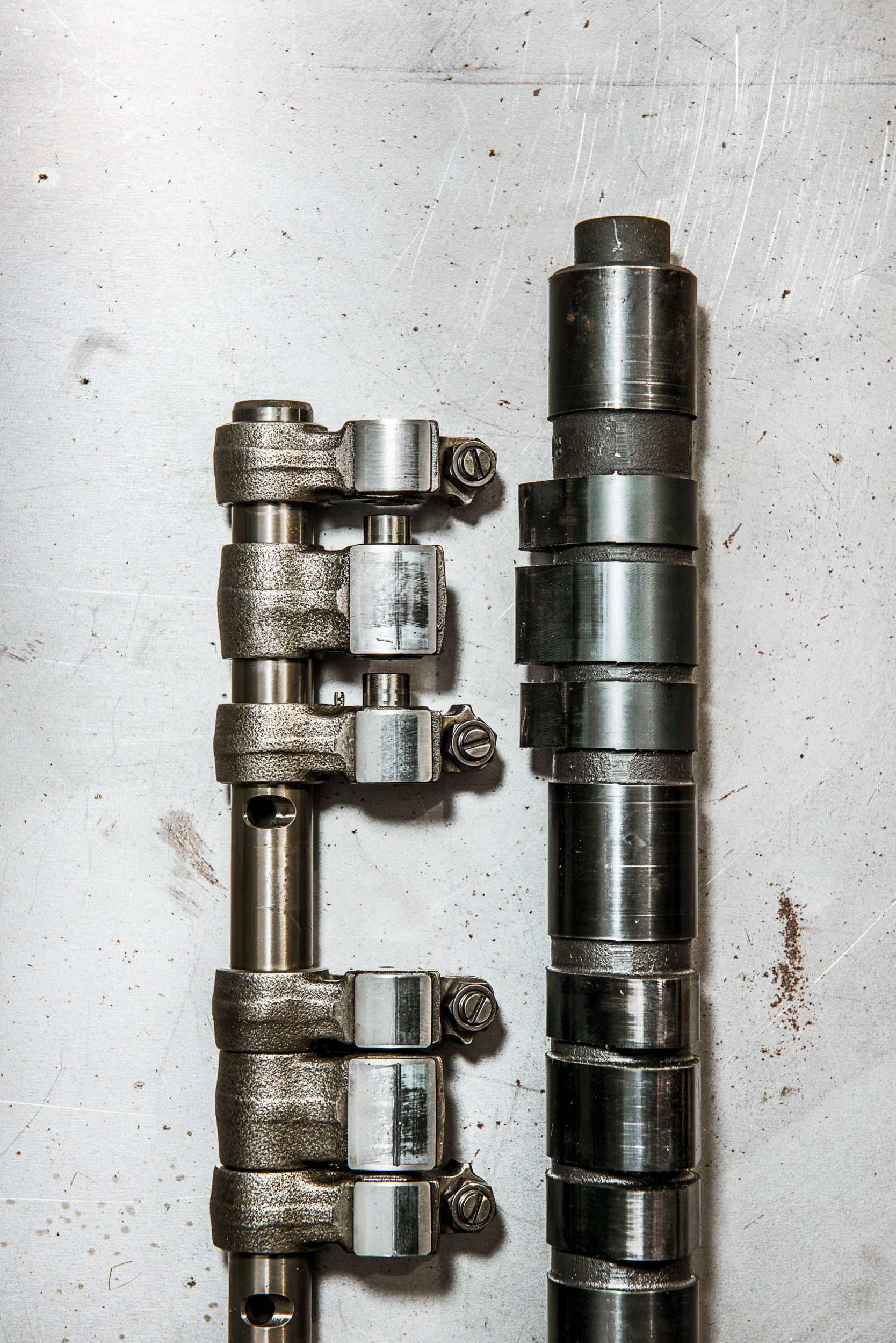 The top rocker arms to the left of the camshaft are spread apart to reveal the pins that link them together when actuated by oil pressure. The bottom set of rockers are arranged the way they lie in the engine.