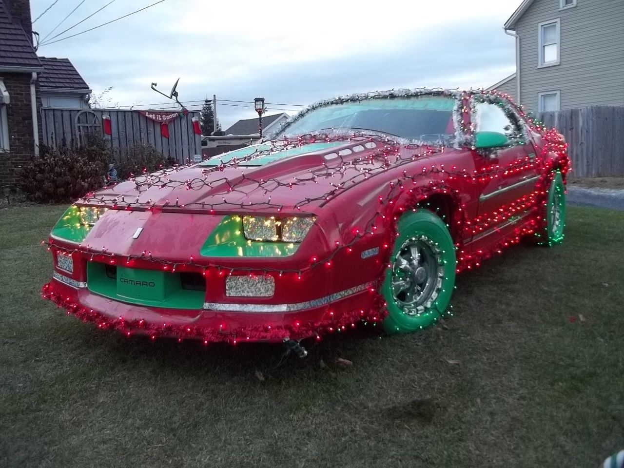This festive Camaro is the ultimate ugly Christmas sweater turned car thumbnail