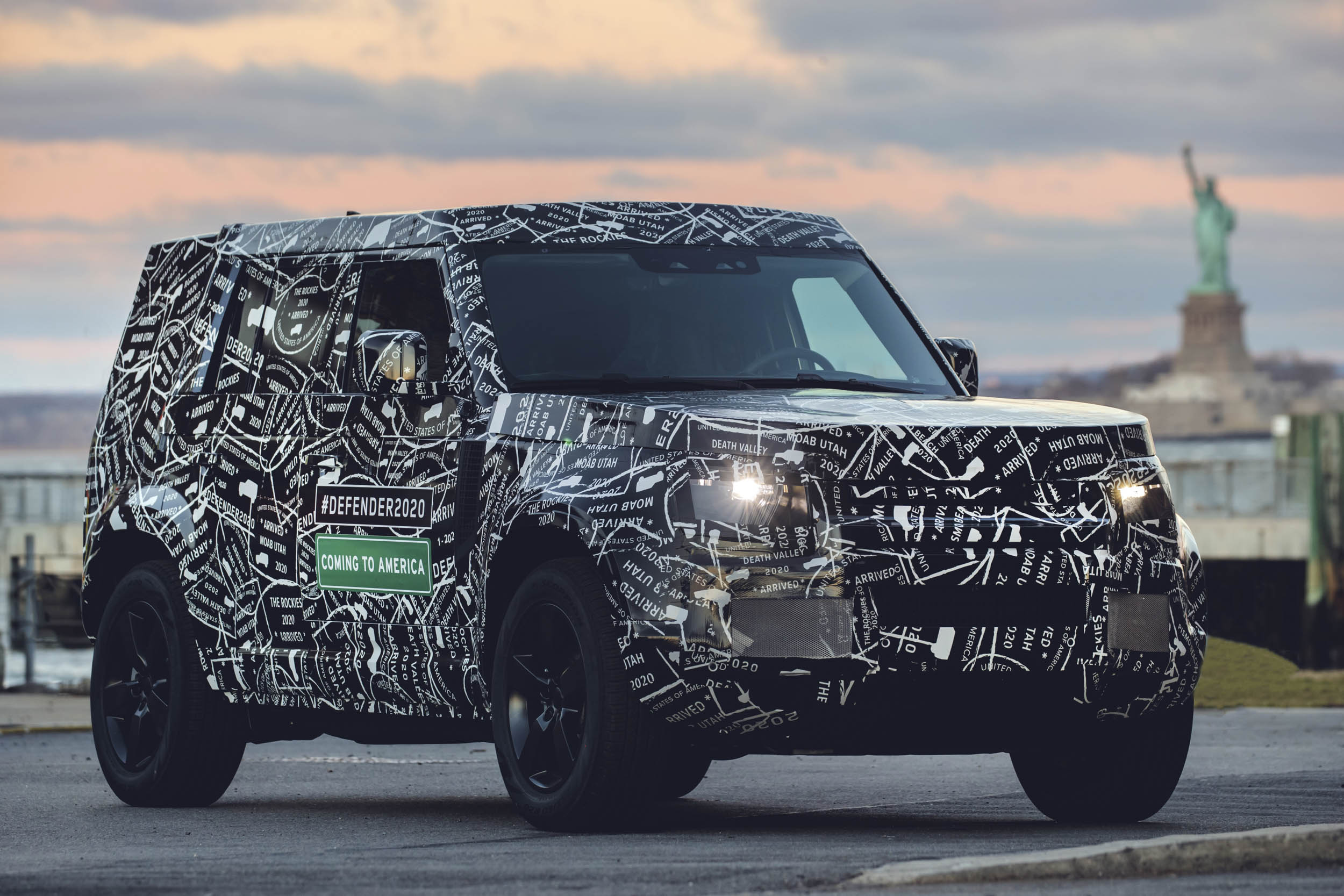 2020 Land Rover Defender front 3/4 in front of the Statue of Liberty