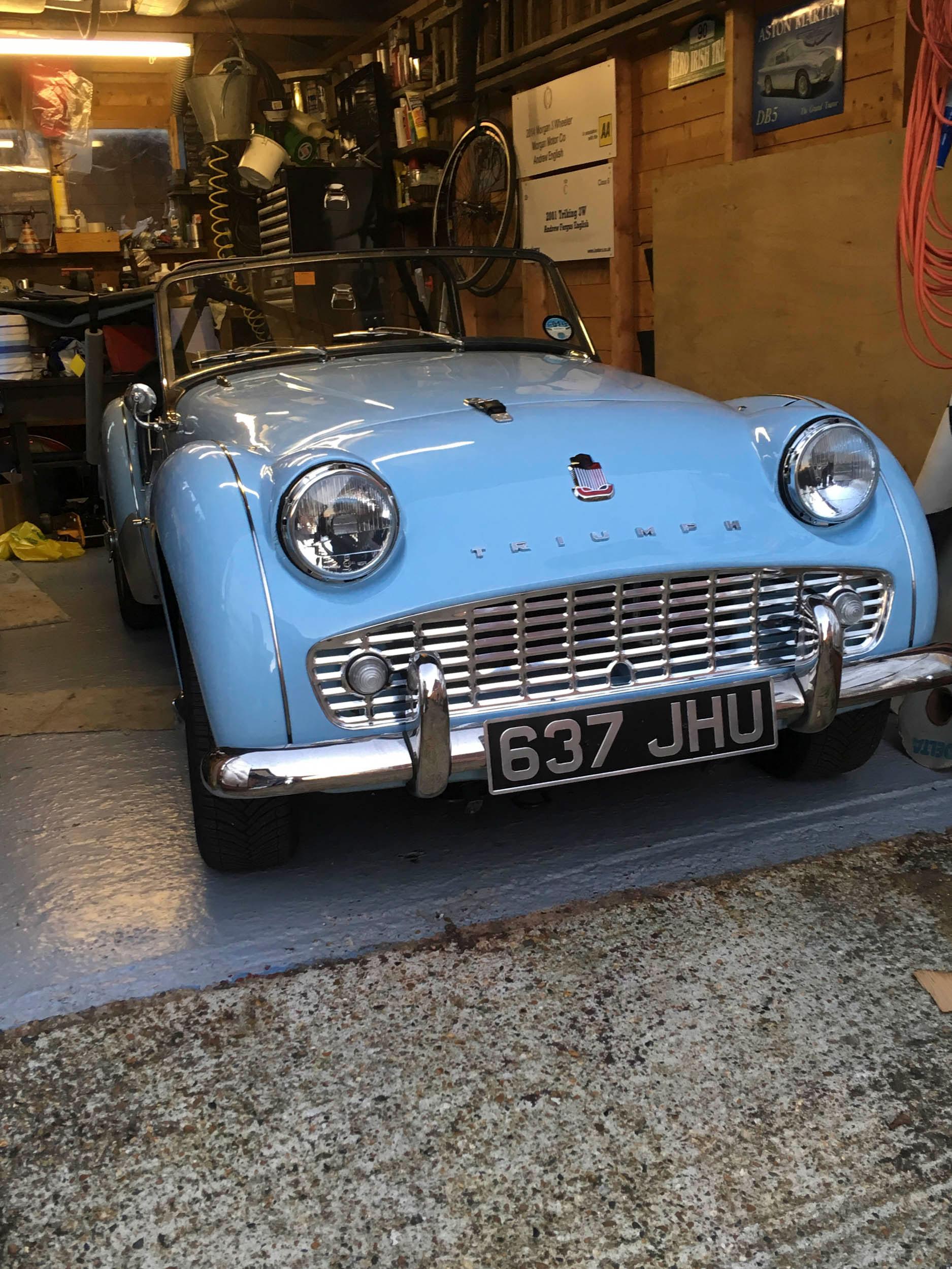 Triumph TR in the garage