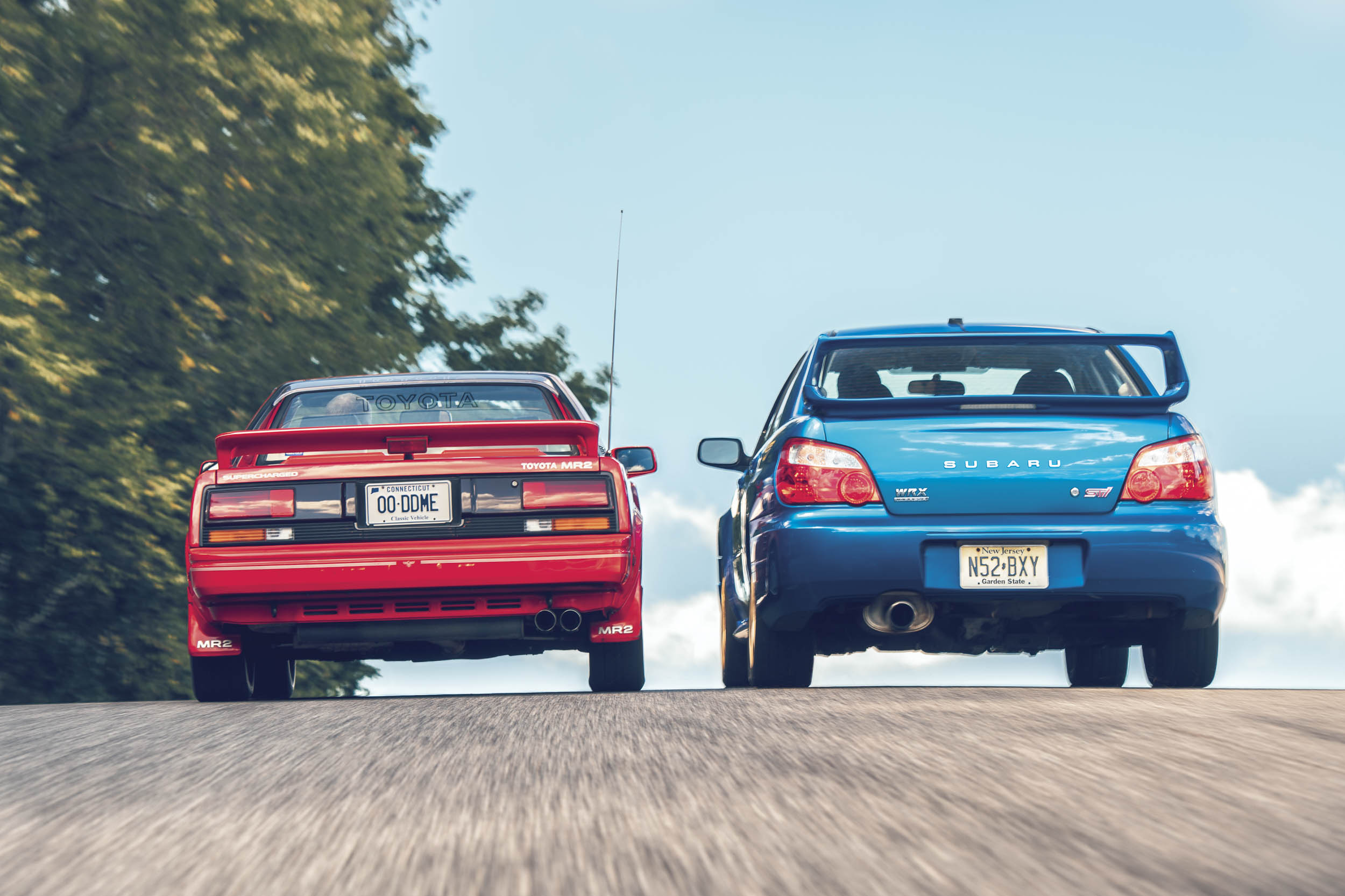 Two decades of design evolution and light-years of technological and philosophical differences separate the original MR2 from the STI.