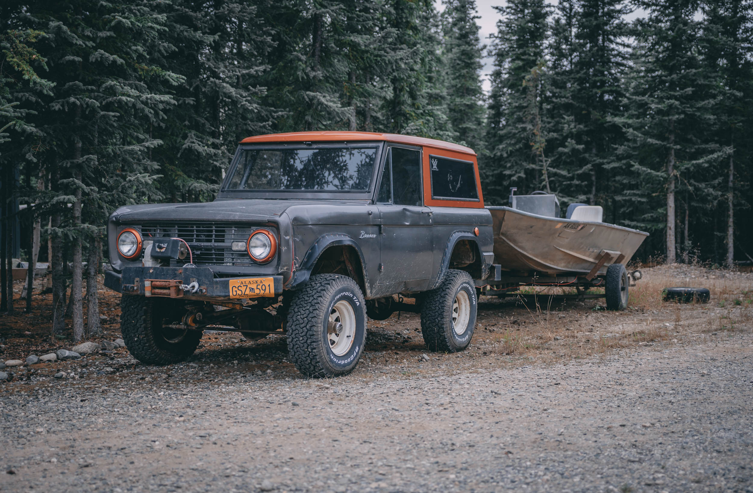 classic Ford Bronco towing a boat