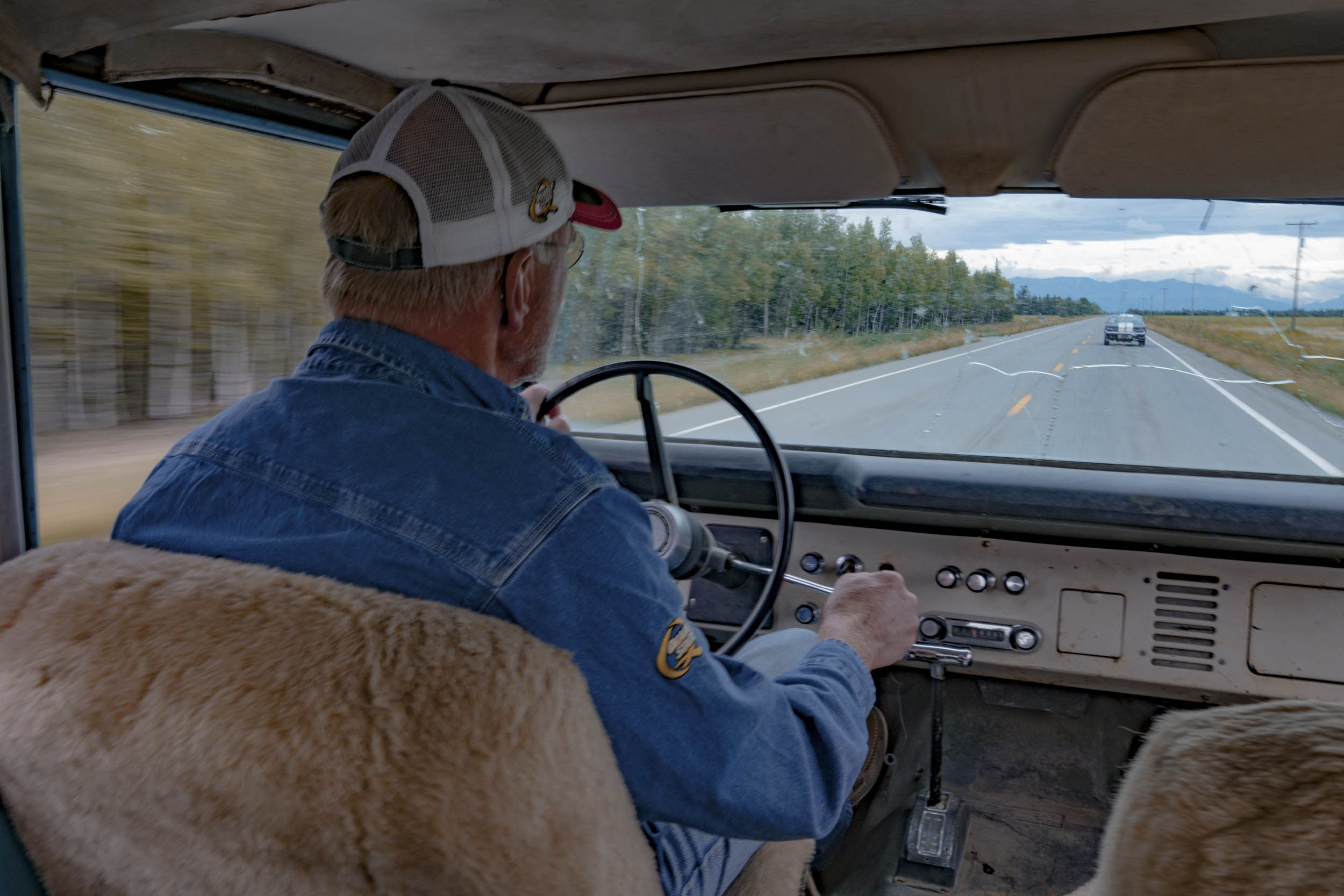 Tom Cotter driving a Ford Bronco