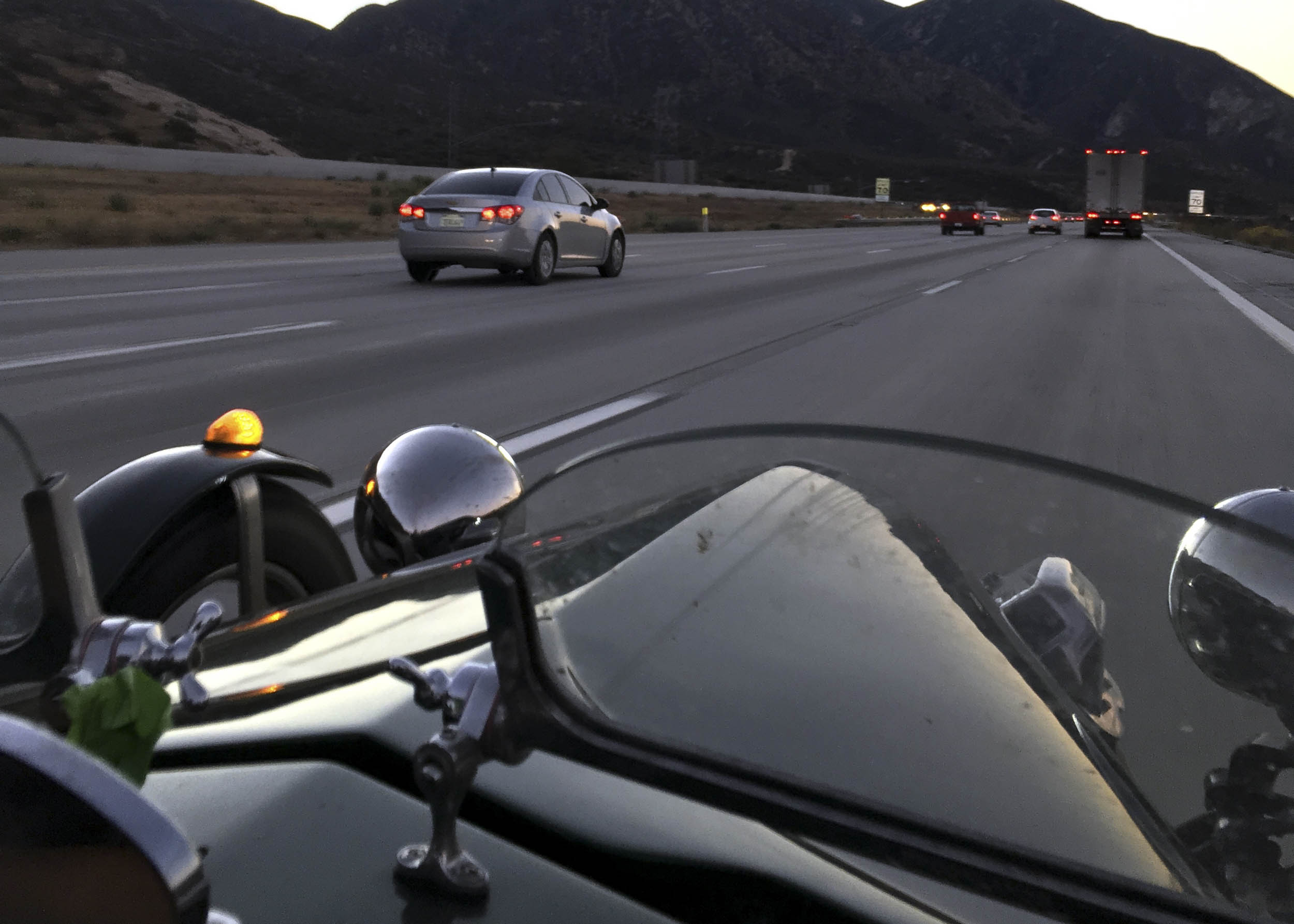 Driving cross country in an open cockpit three-wheeled kit car