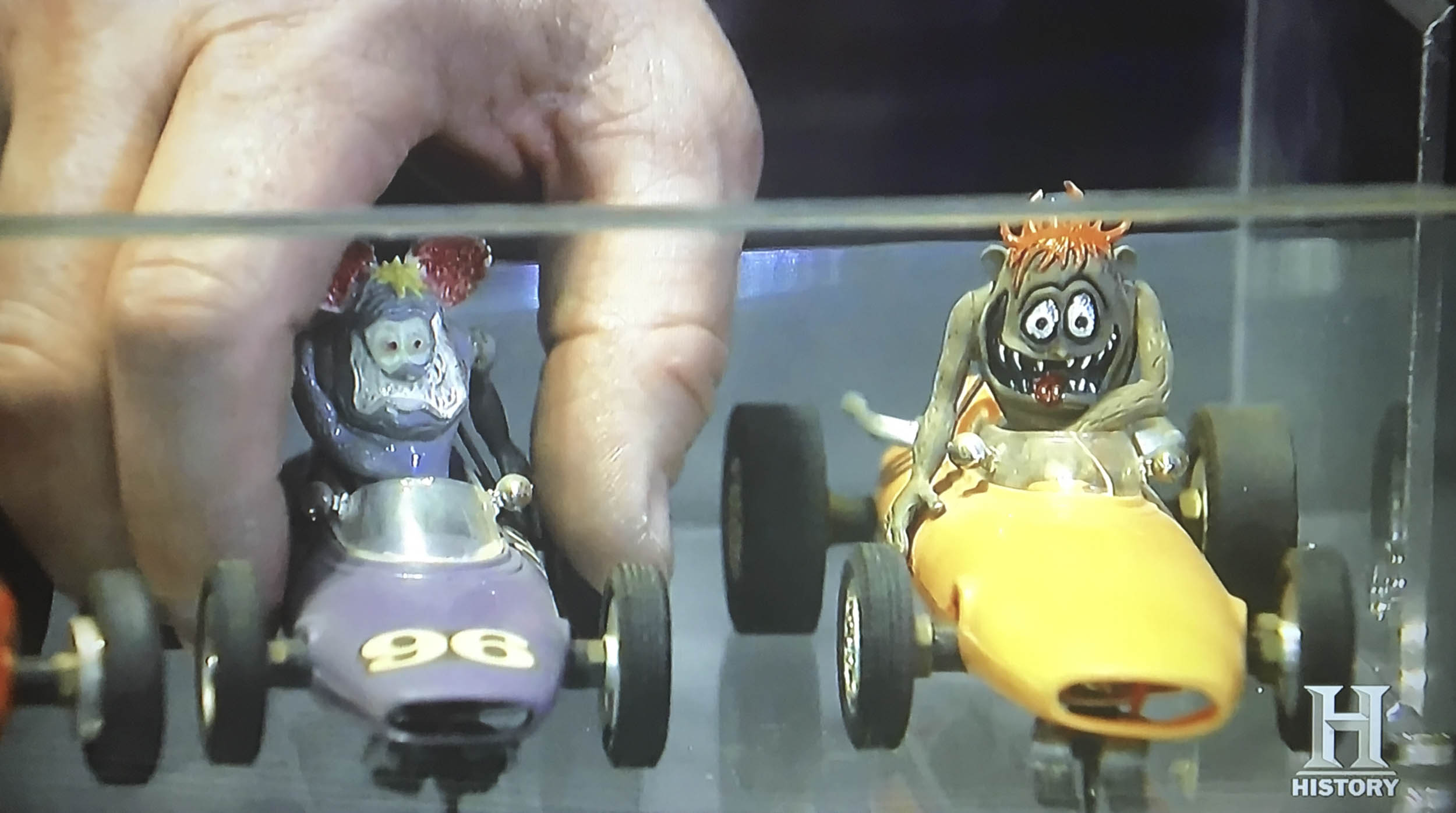 A fan of Big Daddy Roth and his popular cartoon characters Rat Fink and Gasser, Mike Wolfe scored a pair of mid-1960s slot cars for $90 each.