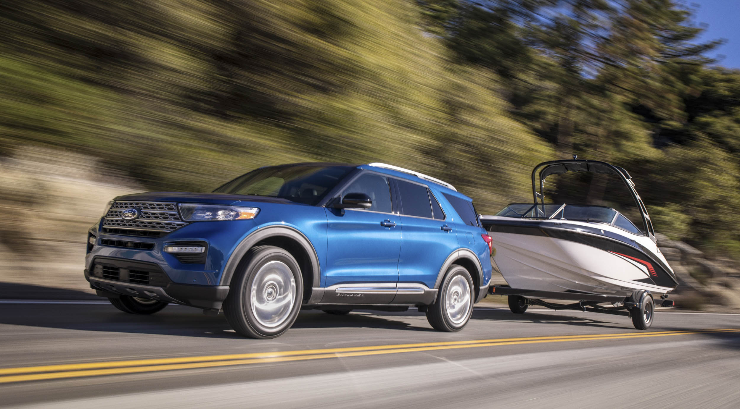 2020 Ford Explorer Hybrid towing a boat