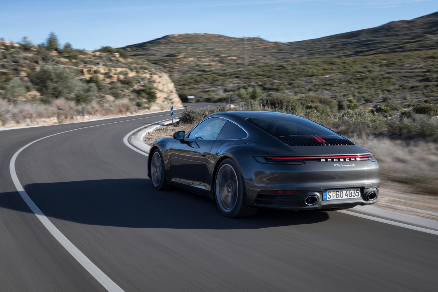 2020 Porsche 911 Carrera S 3/4 rear on road desert