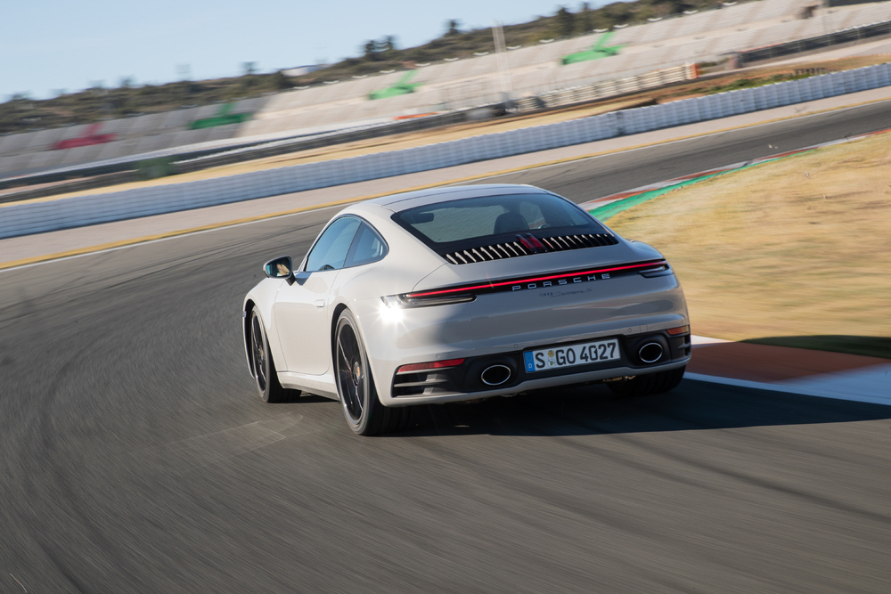 2020 Porsche 911 Carrera S 3/4 rear on track