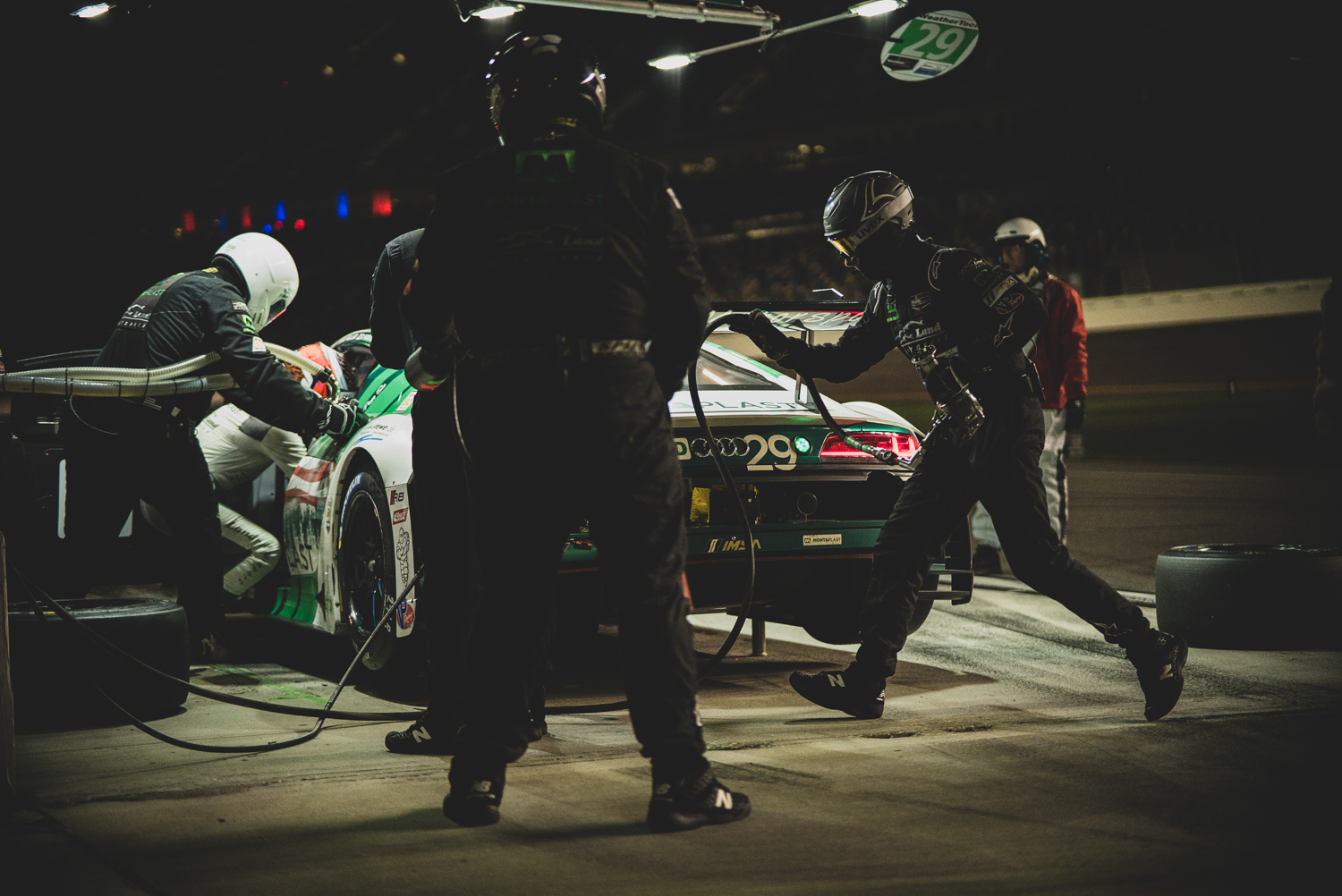 An Audi R8 receives service from its crew in pit lane at 1:15 a.m.